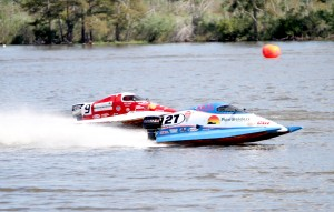 Two boat racers get in some practice Friday afternoon. (Tommy Mann Jr. / The Orange Leader)