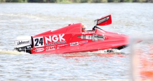Hayden Jacobsen opens the compartment of his racing boat following several laps around the course on the Sabine River on Friday afternoon. (Tommy Mann Jr. / The Orange Leader)