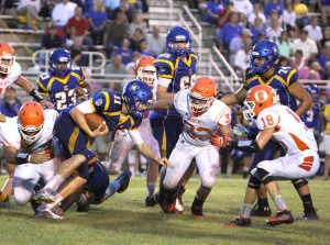 The Bobcats defense kept the high powered aerial attack of the Kelly Bulldogs in check all night with a 21-0 win on Friday night in Beaumont. Defenders Jacob Harrison (62), at left, and Chase Furlough (18) and Blayze Holley surround the Kelly quarterback and prevent a first down. (Tommy Mann Jr. / The Orange Leader)