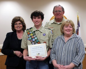 Eagle Scout Chris Bilbo is flanked on his right by Dr. Hargrove and his left by grandparents Chris and Paula Wright as he was recognized by the Board at Monday night's meeting